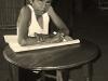 boy-writing-at-table