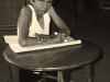 boy-writing-at-table